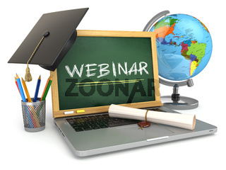 Webinar education concept. Laptop with blackboard, mortar board and diploma.