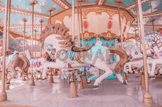 Vintage style empty carousel horse at playground
