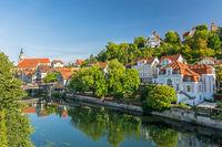 Historic villas along the Neckar river in the German city of Tübingen on a sunny day in summer