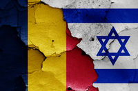 flags of Chad and Israel painted on cracked wall