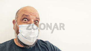 astonished bald man with a mask