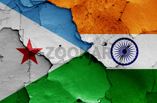 flags of Djibouti and India painted on cracked wall