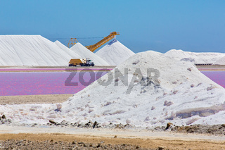 Landscape with salt  hills and transporting truck