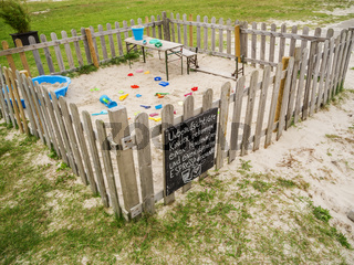 Fenced sandpit with toys