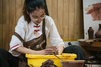 Woman making pottery in China