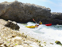 Summer travel kayaking. Man paddling canoe kayak enjoying recreational sporting activity. Male canoeing with paddle exploring sea on vacation