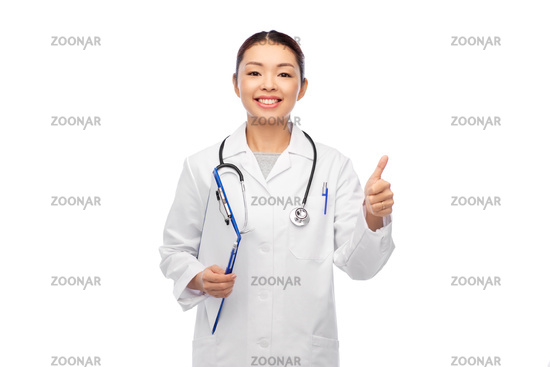 female doctor with clipboard showing thumbs up