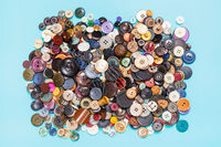 heap of many various buttons on blue background