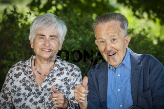 Couple of pensioners thumbs up