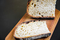 Traditional French country bread slices on a cutting board