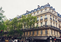 Parisian architecture and historical buildings, restaurants and boutique stores on streets of Paris, France