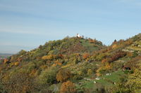 Autumnal landscape with indian summer colours in Wurmlingen, Germany with the chapel St. Remigius (Wurmlinger Kapelle)