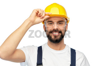 happy male worker or builder in helmet and overall
