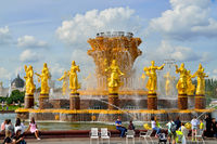 Moscow, Russia - august 25, 2020: tourists inspect fountain Friendship of Peoples, the main fountain and one of the main symbols of VDNKh