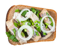 top view of open sandwich salted herring and onion