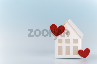 White little house with red hearts