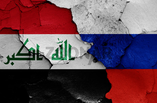 flags of Iraq and Russia painted on cracked wall