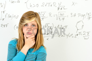 Desperate student girl front of maths board