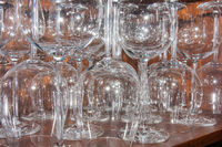 Empty glasses in restaurant cabinet waiting for customers