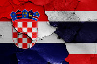 flags of Croatia and Thailand painted on cracked wall
