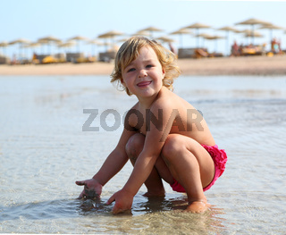 happy child playing on beach