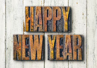 Antique letterpress wood type printing blocks on a white backgound - Happy new year
