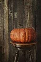 Orange pumpkin against wood background