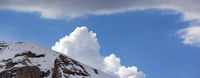 Snow rocks and clouds