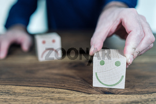 customer service rating and satisfaction concept with wooden toy blocks