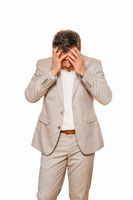 Businessman in beige suite, broken and depressed as his business falling