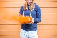 Woman holding Halloween pumpkin