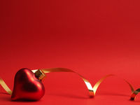 Heart shaped vintage Christmas bauble on a red background