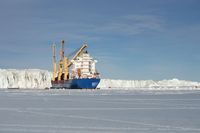 cargo container ship in the sea of Antarctica