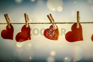 red hearts on clothespins.