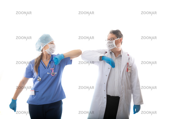 Doctor and nurse elbow bump instead of shaking hands during influenza pandemic