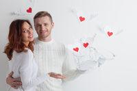 Couple releasing love hearts