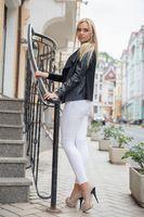 Nice blonde posing near the stairs