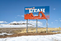 Welcome to Utah, elevated life - road sign with numerous stickers