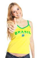 Brazilian sports fan showing thumb up