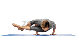 woman making yoga in handstand on mat