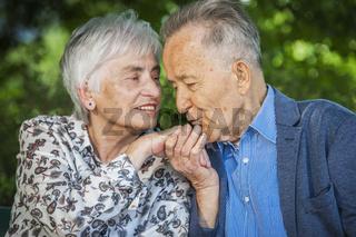 Happy hand kiss seniors