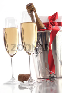Glasses of champagne for Valentine's day with gift and ribbon