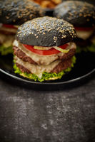 Double beef burger with vegetables and cheese