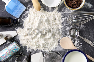 flour with baking and cooking ingredients on table