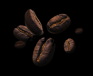 Coffee beans levitate on a black background