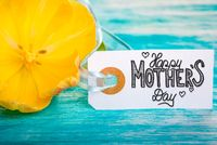 Label With Calligraphy Happy Mothers Day. Yellow Tulip Blossoms