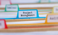 File folders with a tab labeled Project Management