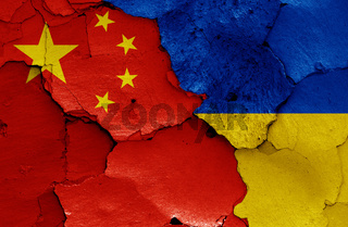 flags of China and Ukraine painted on cracked wall