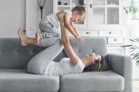 Mother with her son on a sofa in their living room