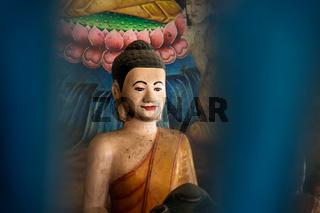 Blue colorful framed buddha statue in temple Wat Krabi Riel Pagoda in Siem Rap Province, Cambodia